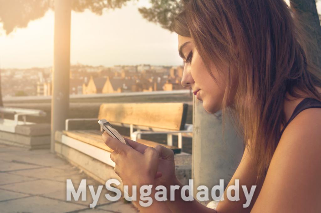 sugar daddy in italia - ragazza al cellulare